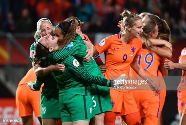 Netherlands' goalkeepers Sari van Veenendaal and Angela Christ celebrate after their team's third goal during the UEFA Womens Euro 2017 football...