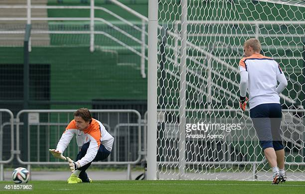 Netherlands' goalkeepers Tim Krul and Jasper Cillessen practise during a training session at Pacaembu Stadium in Sao Paulo Brazil on July 08 2014...