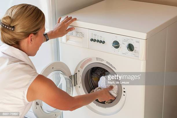Netherlands, Goirle, Woman doing laundry