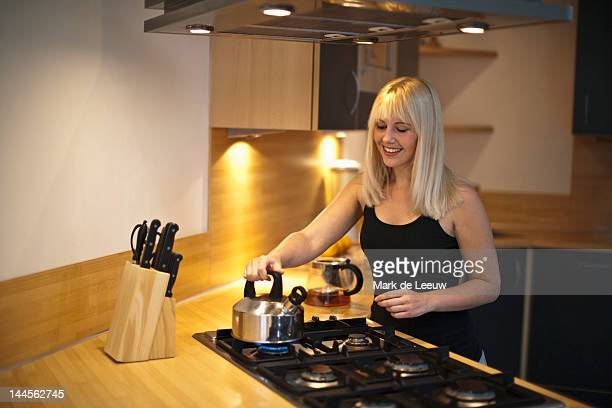 Netherlands, Goirle, Young woman in kitchen