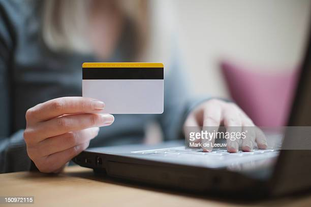 Netherlands, Goirle, Young woman shopping online