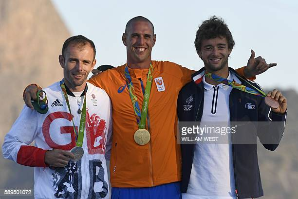 Netherlands' gold medallist Dorian Van Rijsselberghe Britain's silver medallist Nick Dempsey and France's bronze medallist Pierre Le Coq pose on the...