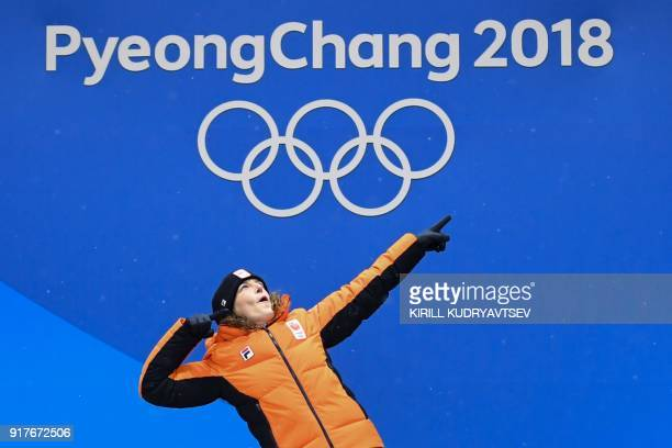 Netherlands' gold medallist Ireen Wust celebrates on the podium during the medal ceremony for the speed skating women's 1500m at the Pyeongchang...