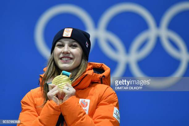 Netherlands' gold medallist Suzanne Schulting poses on the podium during the medal ceremony for the short track Women's 1000m at the Pyeongchang...