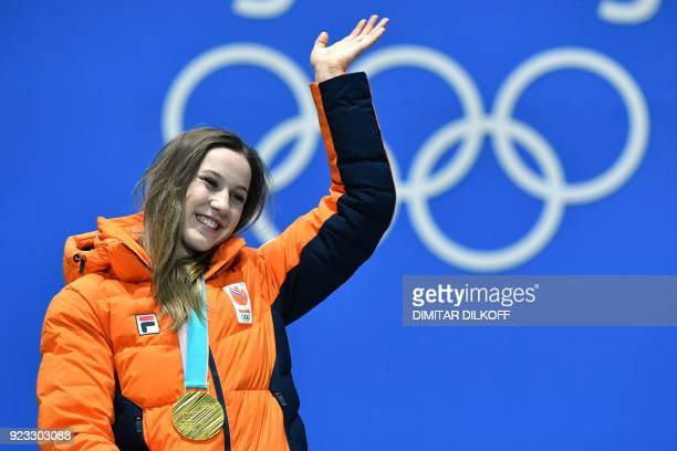 Netherlands' gold medallist Suzanne Schulting waves on the podium during the medal ceremony for the short track Women's 1000m at the Pyeongchang...
