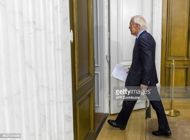 Netherland's government formation mediator Herman Tjeenk Willink leaves after presenting his final report during a press conference in The Hague on...