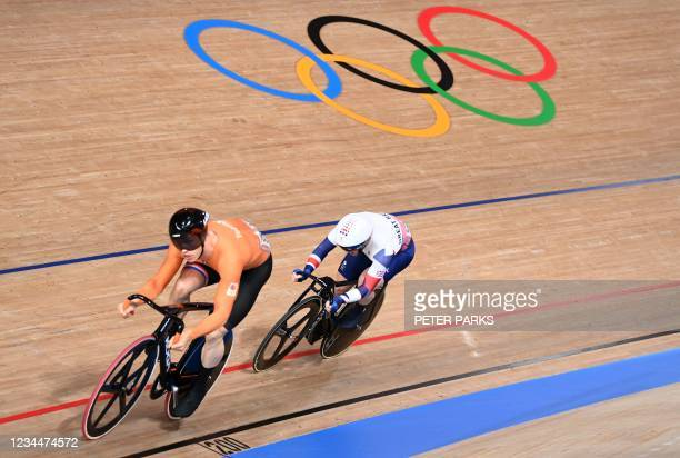 Netherlands' Harrie Lavreysen and Britain's Jason Kenny compete in the first race of the men's track cycling sprint quarter-finals during the Tokyo...