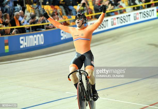 Netherland's Harrie Lavreysen celebrates after victory in the men's team sprint final race at The UCI World Cycling Championships in Apeldoorn on...