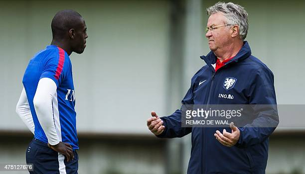 Netherlands' head coach Guus Hiddink speaks with Netherlands's Bruno Martins Indi during a training session on May 29 2015 in Hoenderloo AFP PHOTO /...