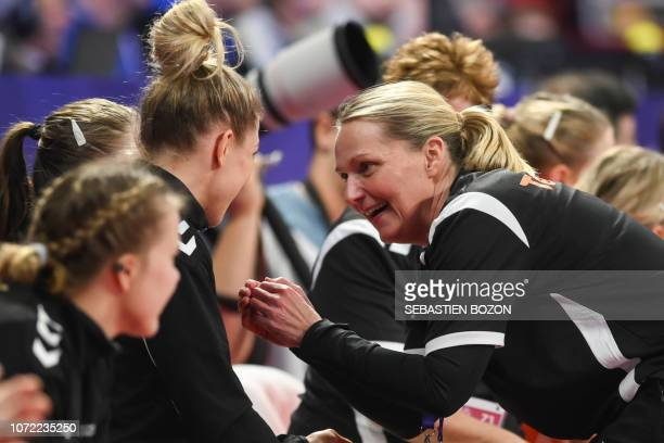 Netherlands' head coach Helle Thomsen speaks with her players during the 2018 European Women's handball Championships Group 2 main round match...