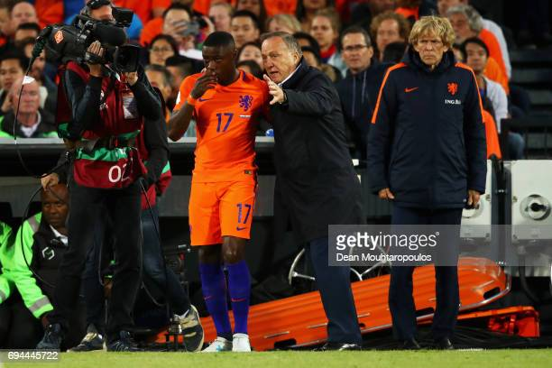 Netherlands Head Coach / Manager Dick Advocaat speaks to sub Quincy Promes during the FIFA 2018 World Cup Qualifier between the Netherlands and...