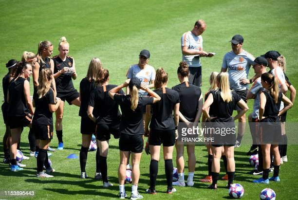 Netherlands' head coach Sarina Wiegman speaks to players during a training session in Oullins near Lyon on July 5 during the France 2019 football...