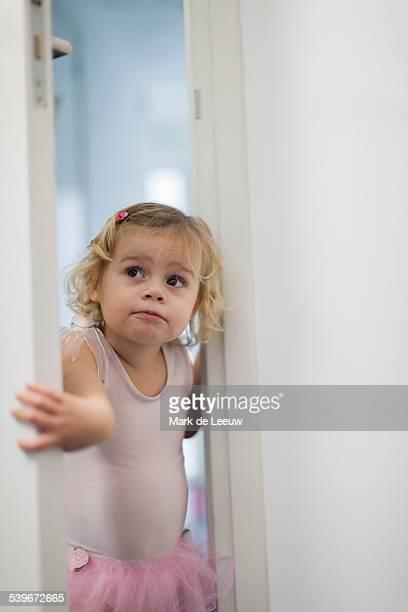 Netherlands, Helvoirt, Girl (2-3) in pink skirt opening bedroom door
