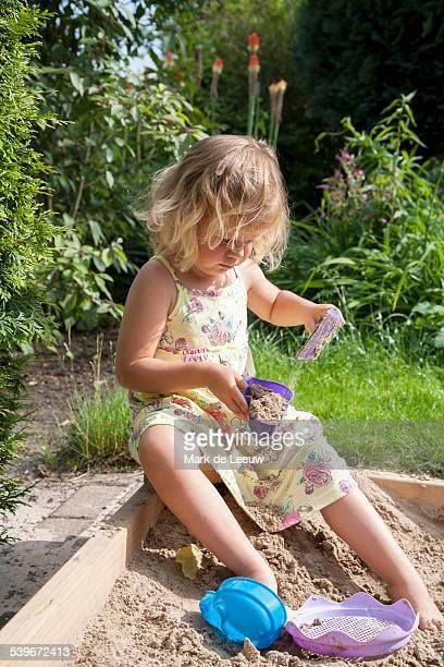 netherlands, helvoirt, little girl (2-3) playing in sandbox - 2 girls 1 sandbox stock photos and pictures