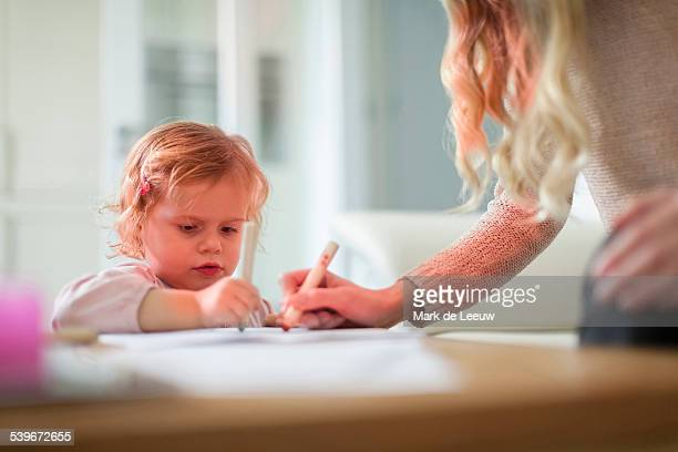 Netherlands, Helvoirt, Mother and daughter(2-3) drawing