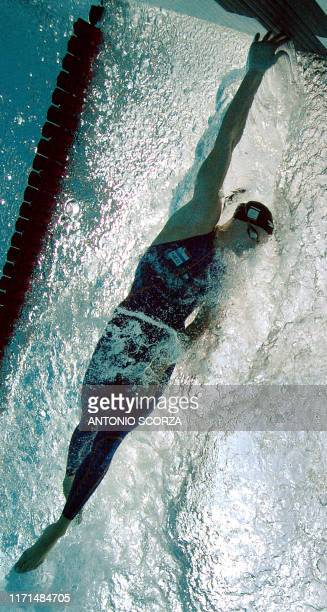 Netherlands' Inge de Bruijn competes during the women's 50m freestyle 21 August 2004 at the Olympic aquatic center at the 2004 Olympic Games in...