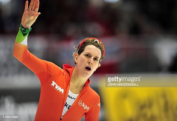 Netherland's Ireen Wuest celebrates her second place in the women's 1000m competition of the International Speedskating World Single Distances Speed...