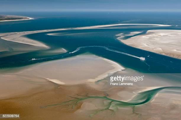 Netherlands, Island Terschelling, group of islands called Wadden Sea. Low tide. Ferryboat. Unesco World Heritage Site. Aerial.