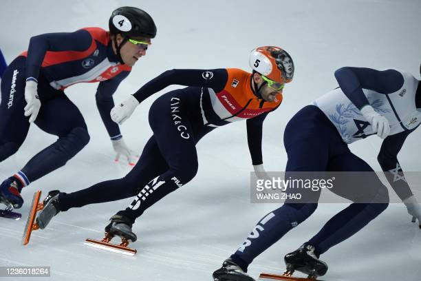 Netherlands' Itzhak de Laat competes in the men's 1500m quarter finals during the 2021/2022 ISU World Cup short track speed skating, part of a 2022...