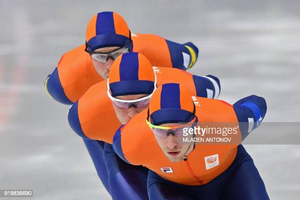 Netherlands' Jan Blokhuijsen leads Netherlands' Koen Verweij and Netherlands' Sven Kramer in the men's team pursuit quarterfinal speed skating event...