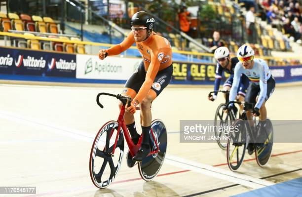 Netherlands' Jan Willem van Schip reacts after winning against France's Benjamin Thomas and belgium's Lindsay de Vylder in the omnium scratch race at...