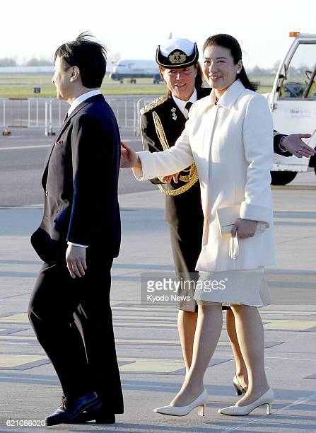 AMSTERDAM Netherlands Japanese Crown Prince Naruhito and Crown Princess Masako walk across the airport tarmac upon arriving in Amsterdam on April 28...