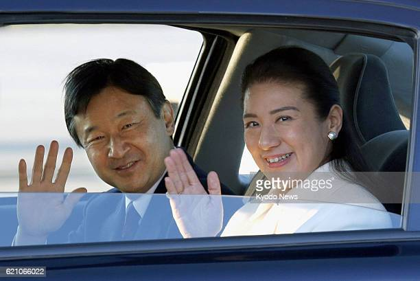 AMSTERDAM Netherlands Japanese Crown Prince Naruhito and Crown Princess Masako wave to reporters upon arriving in Amsterdam on April 28 to attend the...