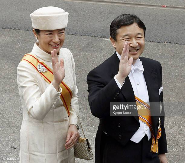 AMSTERDAM Netherlands Japanese Crown Prince Naruhito and Crown Princess Masako wave as they arrive at the Nieuwe Kerk in Amsterdam on April 30 to...