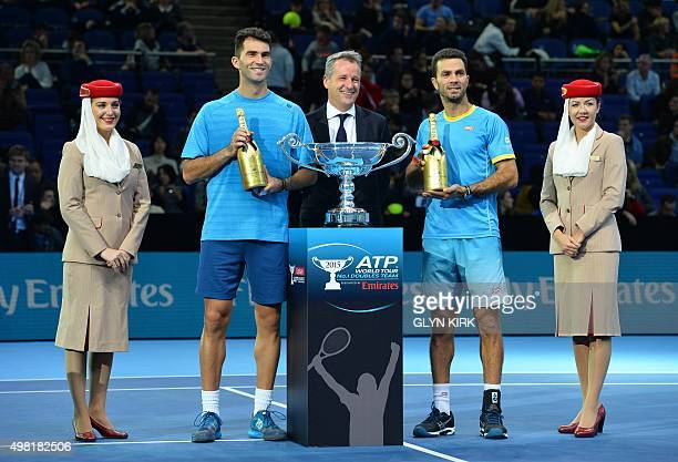 Netherland's JeanJulien Rojer and Romania's Horia Tecau stand with ATP Chairman Chris Kermode as they receive the year ending No 1 position ATP...