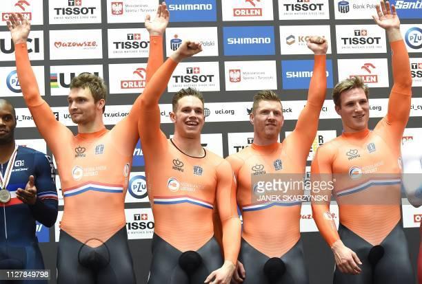 Netherlands' Jeffrey Hoogland, Harrie Lavreysen, Roy van der Berg and Matthijs Buchli celebrate at the podium after winning the men's team sprint...