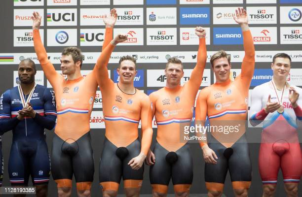 Netherlands' Jeffrey Hoogland Harrie Lavreysen Roy van der Berg and Matthijs Buchli celebrate at the podium after winning the men's team sprint final...