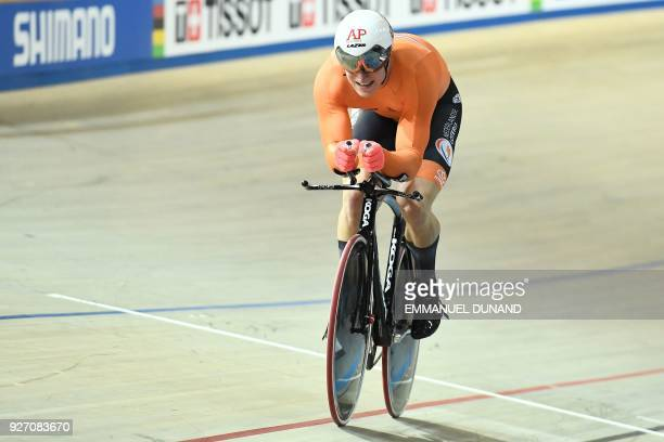 Netherland's Jeffrey Hoogland takes part in the men's one kilometre time trial final during the UCI Track Cycling World Championships in Apeldoorn on...