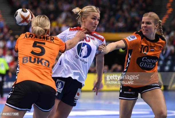 Netherlands' Jessy Kramer and Danick Snelder try to block Norway´s Stine Bredal Oftedal as she shoots during the World Championship semi final match...
