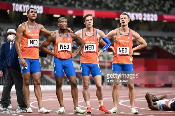 Netherlands' Jochem Dobber, Netherlands' Terrence Agard, Netherlands' Tony van Diepen and Netherlands' Ramsey Angela react after the men's 4x400m...