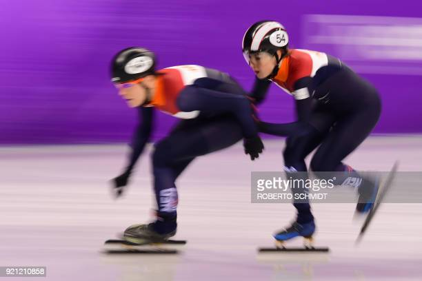 Netherlands' Jorien ter Mors and Netherlands' Lara van Ruijven compete in the women's 3000m relay short track speed skating B final event during the...