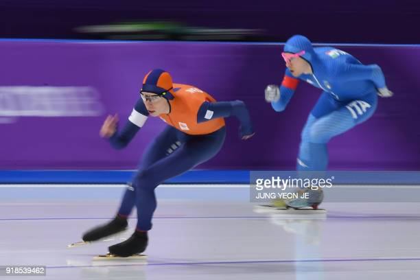 Netherlands' Jorrit Bergsma leads Italy's Davide Ghiotto in the men's 10,000m speed skating event during the Pyeongchang 2018 Winter Olympic Games at...
