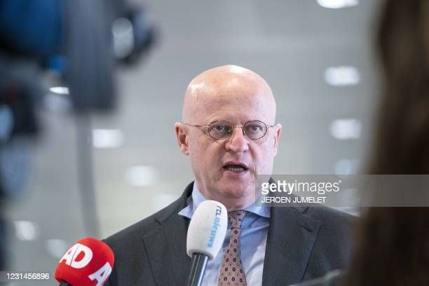 Netherlands' Justice and Security minister Ferd Grapperhaus answers journalists' questions as he arrives for the Security Council in Utrecht, on...