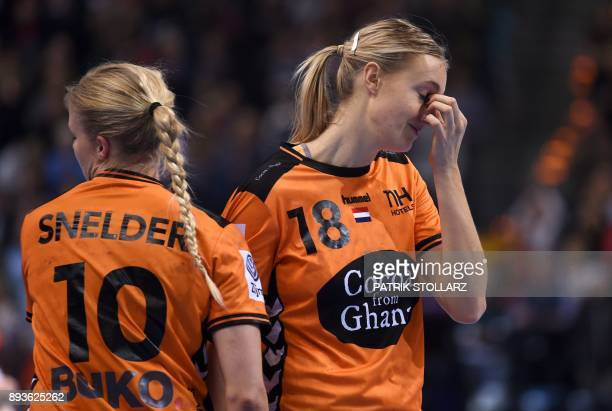 Netherlands' Kelly Dulfer and Danick Snelder react after they lost the IHF Womens World Championship handball halffinal match between Norway and...