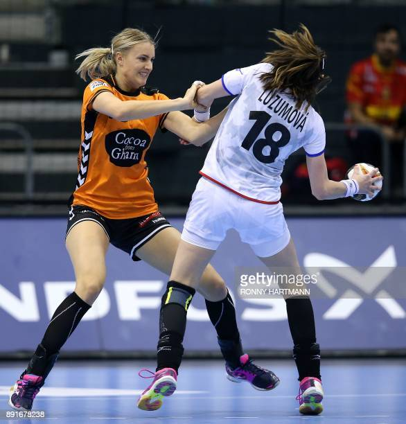 Netherland's Kelly Dulfer vies with Czech Republic's Iveta Luzumova during the IHF Womens World Championship handball quater final match between...