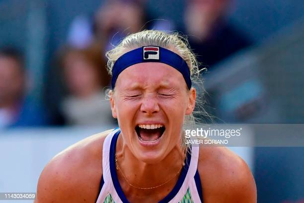 Netherlands' Kiki Bertens celebrates after defeating Romania's Simona Halep during their WTA Madrid Open final tennis match at the Caja Magica in...