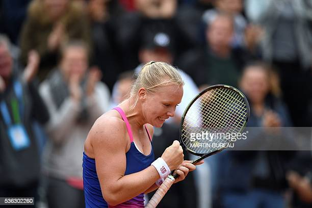 Netherlands' Kiki Bertens celebrates after winning her women's fourth round match against US player Madison Keys at the Roland Garros 2016 French...