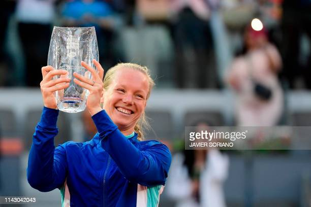Netherlands' Kiki Bertens celebrates in the podium after winning the WTA Madrid Open final tennis match at the Caja Magica in Madrid on May 11, 2019.