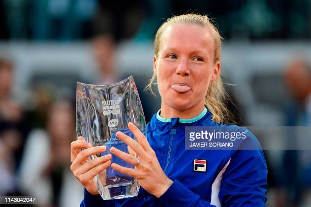 TOPSHOT Netherlands' Kiki Bertens celebrates in the podium after winning the WTA Madrid Open final tennis match at the Caja Magica in Madrid on May...