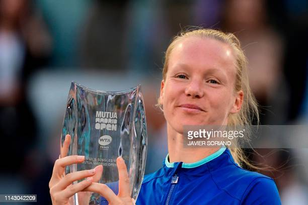 Netherlands' Kiki Bertens celebrates on the podium after winning the WTA Madrid Open final tennis match at the Caja Magica in Madrid on May 11 2019