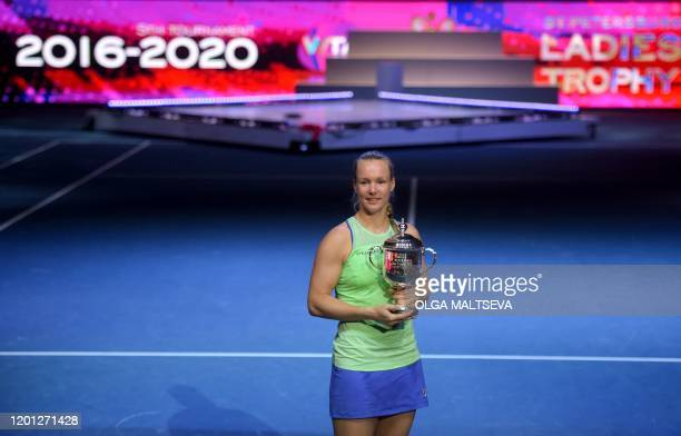 Netherlands' Kiki Bertens poses with the trophy after her victory over Kazakhstan's Elena Rybakina in their women's singles final tennis match at the...