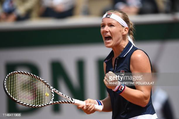 TOPSHOT Netherlands' Kiki Bertens reacts after winning against France's Pauline Parmentier during their women's singles first round match on day two...