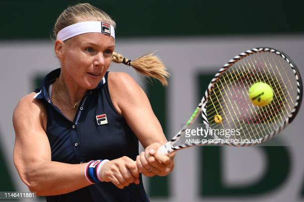 TOPSHOT Netherlands' Kiki Bertens returns the ball to France's Pauline Parmentier during their women's singles first round match on day two of The...