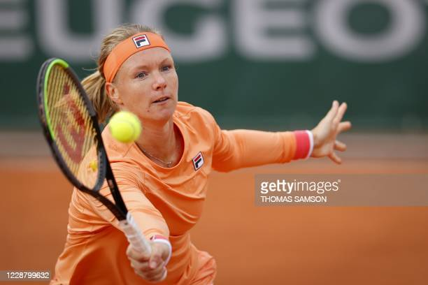Netherlands' Kiki Bertens returns the ball to Italy's Sara Errani during their women's singles second round tennis match on Day 4 of The Roland...