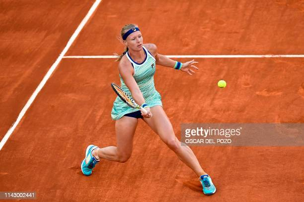 Netherlands' Kiki Bertens returns the ball to Romania's Simona Halep during their WTA Madrid Open final tennis match at the Caja Magica in Madrid on...