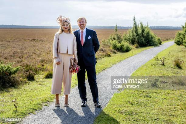 Netherlands' King Willem-Alexander and his wife Queen Maxima pose for a photo on September 18, 2019 in Hoogeveen, as they visit the Dwingelderveld...